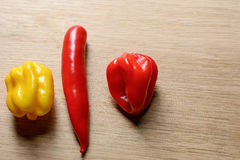 Strong chilies together. Very strong chlies together on a wooden cutting board Stock Photography