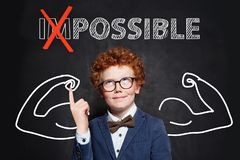 Strong clever child boy with text possible on black background. Success and develop concept.  royalty free stock images