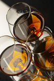 Strong cognac. Three glasses with strong cognac Stock Photo