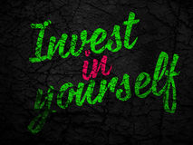 Strong colorful conceptual message: INVEST IN YOURSELF Royalty Free Stock Images