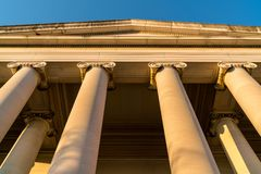Classical Building pillars security strong concept. A strong concept with the warm facasde of a classical architectural design building of the government or stock photos