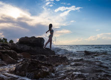 Strong confidence woman open arms under the  sunrise at seaside. Strong confidence woman open arms under the sunrise at seaside Royalty Free Stock Image