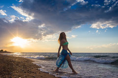 Strong confidence woman open arms under the  sunrise at seaside. Strong confidence woman open arms under the sunrise at seaside Royalty Free Stock Photo