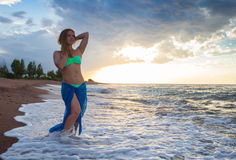 Strong confidence woman open arms under the  sunrise at seaside. Strong confidence woman open arms under the sunrise at seaside Stock Images
