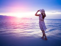 Strong confidence woman open arms under the sunrise at seaside.  stock images