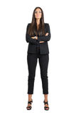 Strong confident business woman with folded arms looking at camera head leaned back Royalty Free Stock Photo