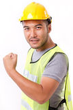 Strong and confident construction worker. On white background Stock Photography