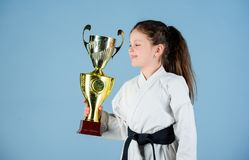 Strong and confident kid. Girl little child in white kimono with belt. Karate fighter child. Karate sport concept. Self. Defence skills. Karate gives feeling of royalty free stock photography