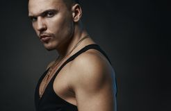 Strong confident man in a black t-shirt Stock Photo