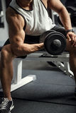 Strong confident man building up physical strength Royalty Free Stock Photo