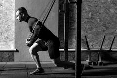 Free Strong Confident Man Exercising In A Gym Royalty Free Stock Photography - 81894617