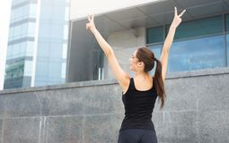 Strong and confident woman with hands in air Stock Images