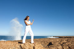 Strong and confident woman at ocean background Stock Photography