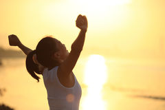 Strong confident woman open arms on beach. Strong confident woman open arms on sunrise beach stock image