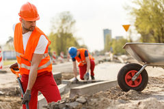 Strong construction worker digging Stock Photography