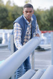 Strong construction worker rolling concrete pipe Stock Photos