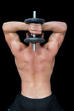 Strong crossfitter lifting up heavy black dumbbell behind head Stock Image