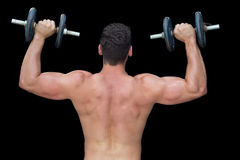 Strong crossfitter lifting up heavy black dumbbells Stock Images