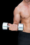 Strong crossfitter lifting up heavy dumbbell Stock Image