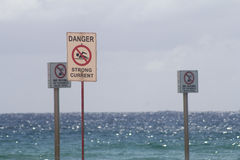 Strong Current. Beach signs. Danger strong current. No diving Stock Image