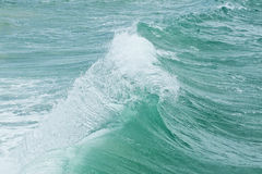 Strong currents causing a wave Royalty Free Stock Photo