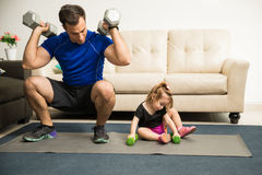 Strong dad impressing her daughter Stock Photo
