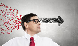 Strong decision making ability. Thoughtful adult businessman with arrows and thoughts coming out of his head Royalty Free Stock Photography