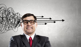 Strong decision making ability. Thoughtful adult businessman with arrows and thoughts coming out of his head Stock Images
