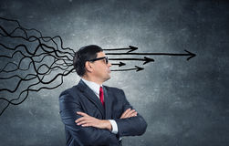 Strong decision making ability. Thoughtful adult businessman with arrows and thoughts coming out of his head Royalty Free Stock Image