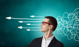 Strong decision making ability. Thoughtful businessman with arrows and thoughts coming out of his head Royalty Free Stock Image