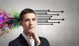 Strong decision making ability. Thoughtful businessman with arrows and thoughts coming out of his head Royalty Free Stock Images