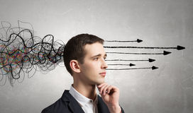 Strong decision making ability. Thoughtful businessman with arrows and thoughts coming out of his head Stock Photography