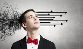 Strong decision making ability. Thoughtful businessman with arrows and thoughts coming out of his head Royalty Free Stock Photo