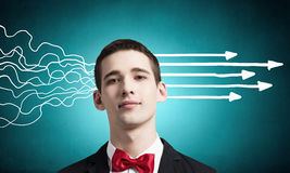 Strong decision making ability. Thoughtful businessman with arrows and thoughts coming out of his head Stock Image