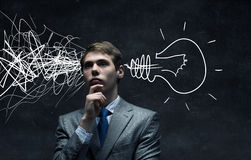 Strong decision making ability. Thoughtful businessman with arrows and thoughts coming out of his head Stock Photos