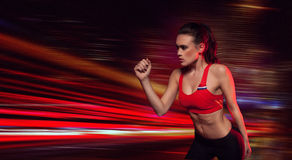 Strong determined female athlete Stock Image