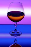 Strong drink. On a multicolor background Stock Images