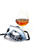 Strong drink and mask Royalty Free Stock Photo