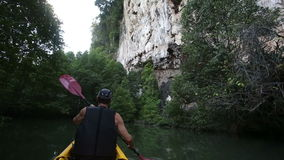 Strong elder man rows kayak with sound stock video footage