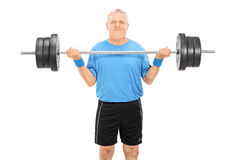Strong elderly man holding a heavy weight Royalty Free Stock Photos