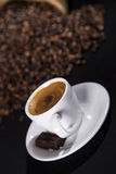 Strong espresso. A cup of fresh espresso with coffee beans Royalty Free Stock Image