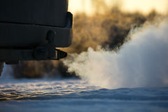 Strong exhaust smoke coming from behind the car. Royalty Free Stock Images