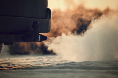 Free Strong Exhaust Smoke Coming From Behind The Car. Stock Photo - 76441050