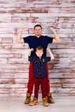 Father and son show muscles