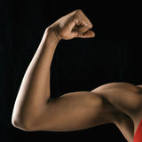 Strong female bicep flexing.
