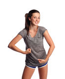 Strong female teenager. Attractive teenager is flexing her muscles and having fun royalty free stock images