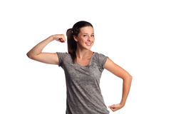 Strong female teenager. Attractive teenager is flexing her muscles and having fun stock photos