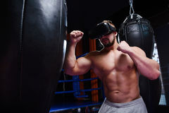 Strong fighter in virtual reality glasses Stock Images