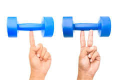 A strong finger and two strong fingers holding dumb bell isolated. On white background Royalty Free Stock Images