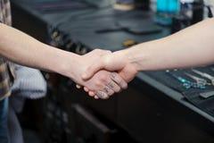 Strong firm handshake in barbershop Stock Photos
